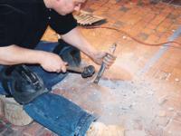 REMOVAL OF INDIVIDUAL WORN TILES USING CHISEL AND HAMMER